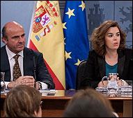 Luis de Guindos y Soraya Saenz de Santamaría